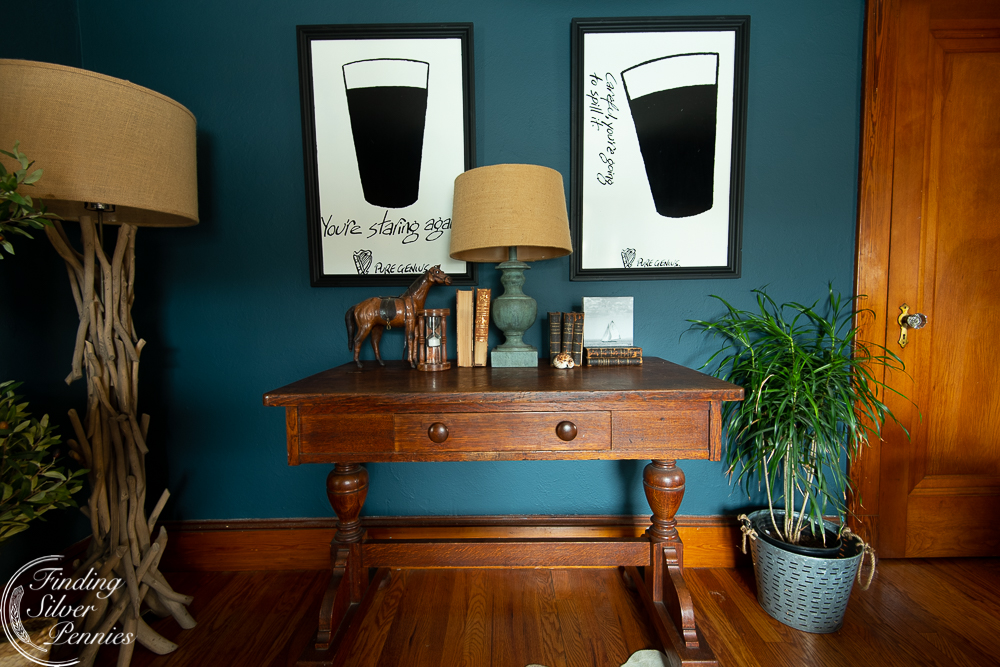 Vintage metal Guinness photos and a Stickley library table