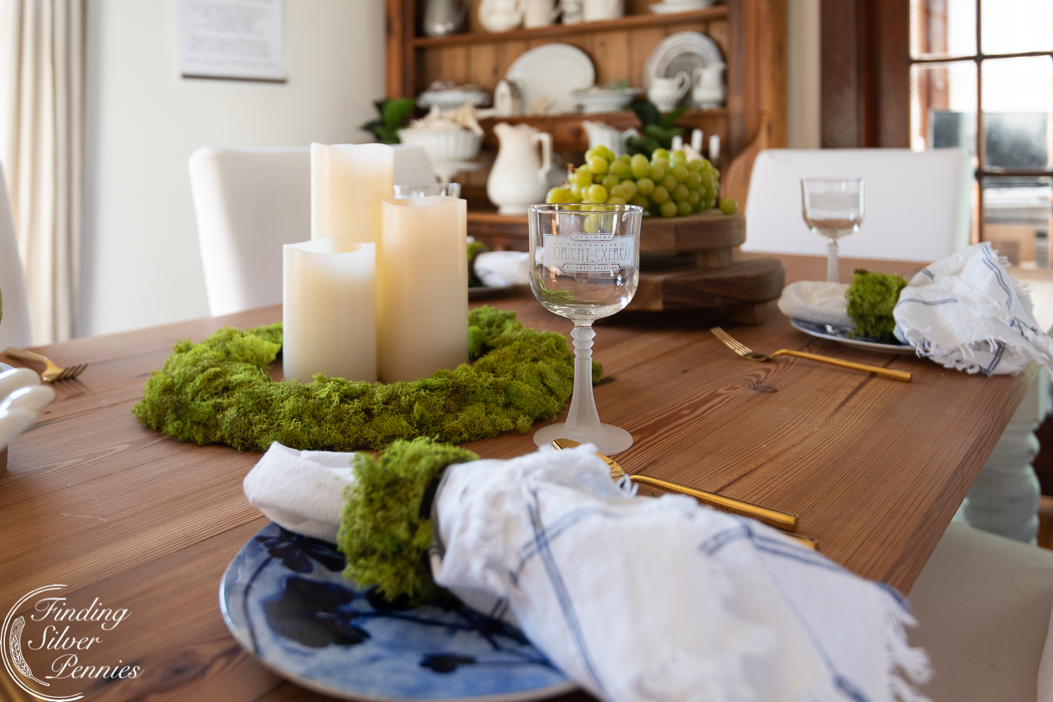 Winter tablescape with moss #moss #crafts #DIYmosswreath #diymossnapkinrings #winterdecorating #hygge #cozyliving