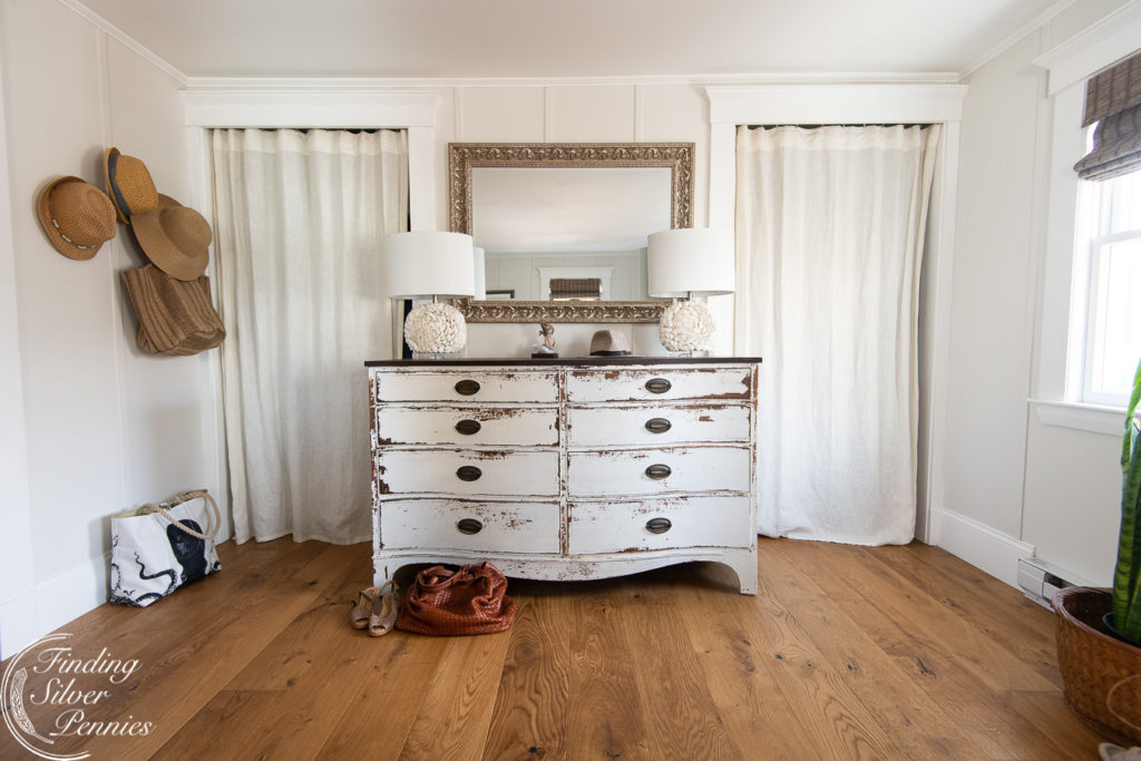 Wide plank floors make this bedroom feel so inviting. Learn how we care for our floors and if we'd recommend them for your home.