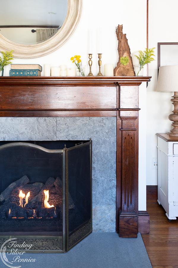 Original dark wood mantel gets lightened up for spring #spring #mantel #flowers #seasonalsimplicity