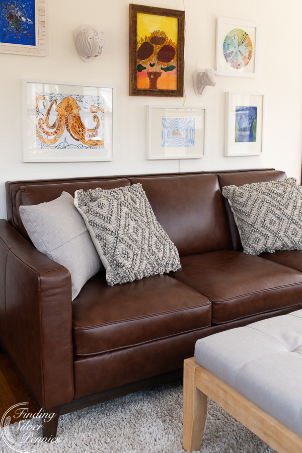A leather couch with modern lines is perfect for a grown up playroom   Finding Silver Pennies #playroom #boysroom #modern