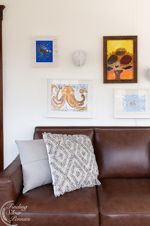 Lovely kids art adds color to the gallery wall in their playroom   Finding Silver Pennies