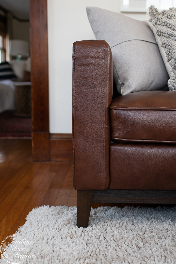 A dreamy leather couch and soft shag carpet - elements from the playroom makeover   Finding Silver Pennies #homedecor #design #playroom #diy