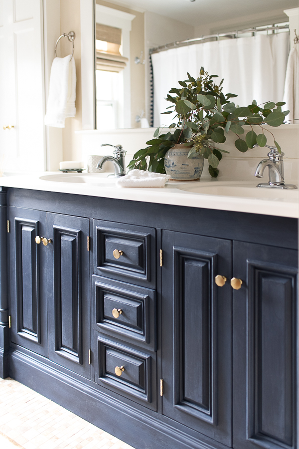 navy vanity with soft brass hardware